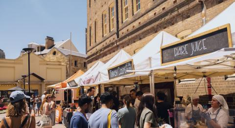 Crowds enjoying a visit to The Rocks Friday Foodie Market along Playfair Street, The Rocks