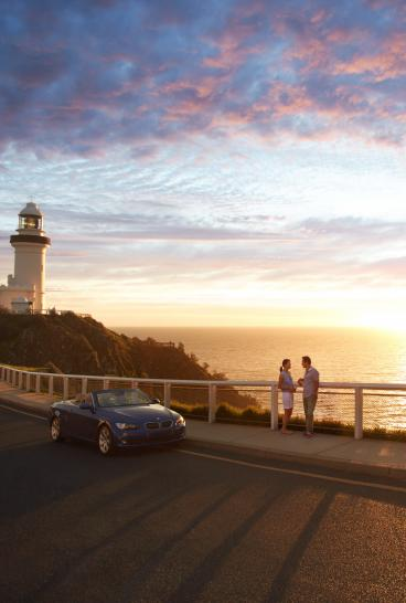 A couple enjoying sunrise at the Cape Byron Bay Lighthouse, Byron Bay